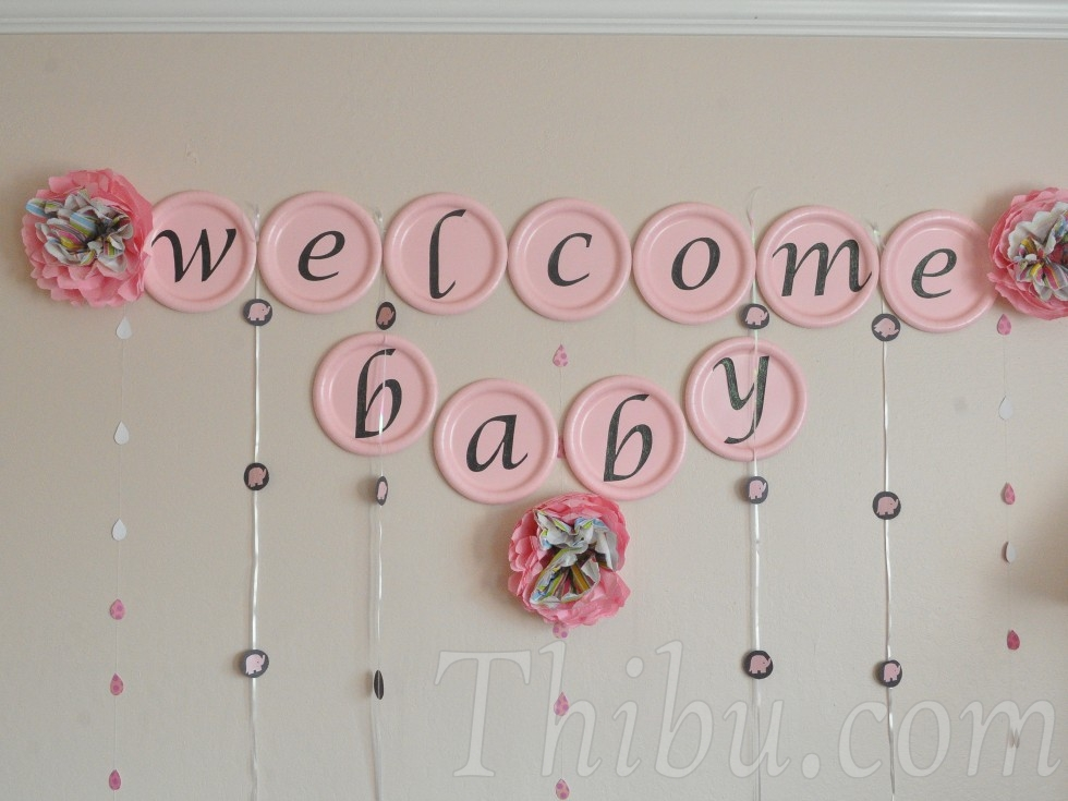 Pink and chocolate elephant themed baby shower decor for Baby welcome home decoration